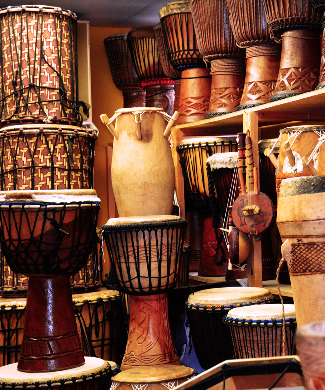 African Drums and Art Crafts Saikou Kensington Market Dundas St West Toronto Canada Shop Workshops Lessons Classes Masks Furniture Fabric Drum Circles Crafts Performances Shows Entertainment